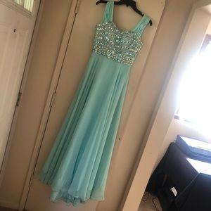 Teal prom dress with beaded bodess